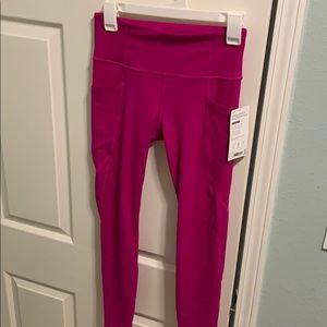 Athleta Pants - Athleta Stash Pocket Salutation Tight
